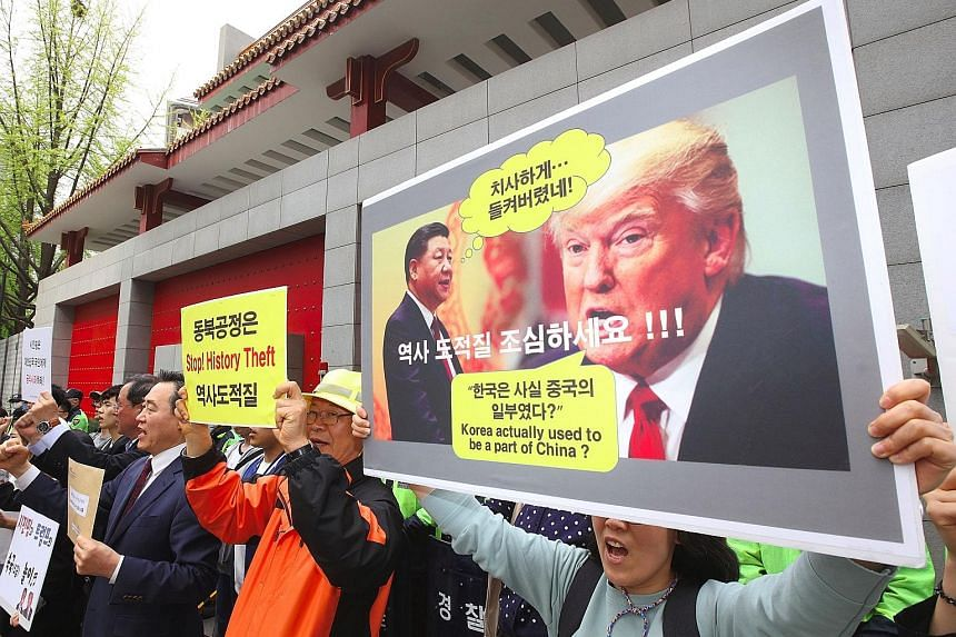 South Korean historians and activists protesting outside the Chinese Embassy in Seoul on Friday. The exact details of what Mr Xi Jinping said and whether Mr Donald Trump accurately quoted him are unknown.