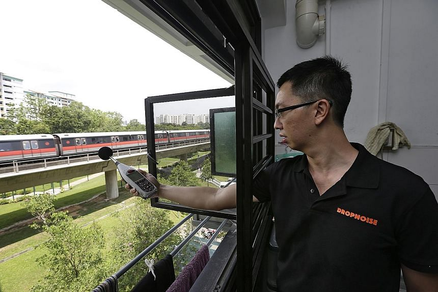 Mr Spencer Tan of noise monitoring firm Dropnoise measuring the noise level at Block 537, Choa Chu Kang Street 51, last Wednesday.