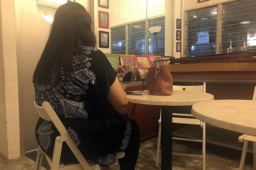 Ms Chloe Lin (not her real name) at the office of voluntary welfare organisation Beyond Social Services. Twice divorced, she struggles to hold on to a job and now lives in a one-room rental flat in Ang Mo Kio with her daughter. She gets $360 a month