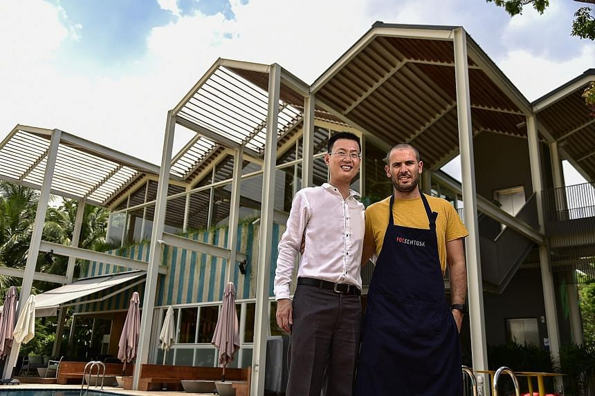 Human resources director New Kheng Tiong, 43, and executive chef Eche Garcia Pau, 32, at FOC Sentosa. The restaurant chain has helped to provide training to individuals who lack the relevant qualifications.