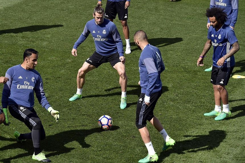 (From left) Real Madrid's Costa Rican goalkeeper Keylor Navas, Welsh forward Gareth Bale and French forward Karim Benzema training for today's Clasico against Barcelona. Bale was named to the 20-man squad but is doubtful for the game. Still, Real hav