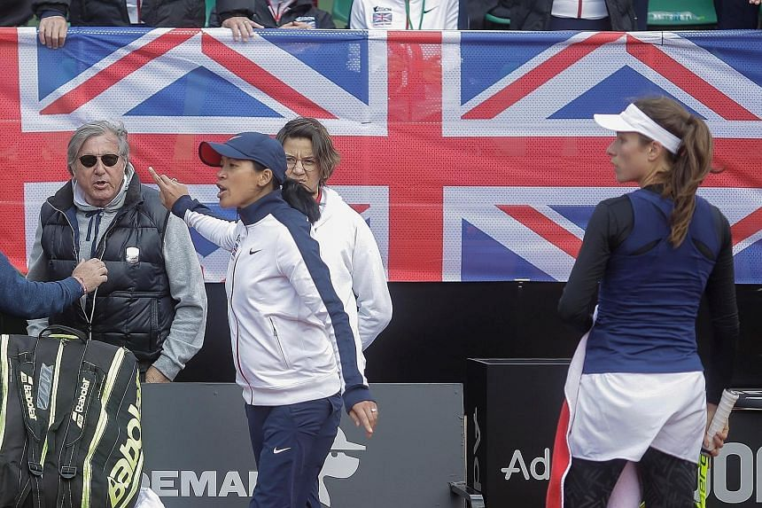Britain's head coach Anne Keothavong gestures towards Romania's head coach Ilie Nastase during the Fed Cup Group II play-off yesterday. The veteran, who won the 1972 US Open and 1973 French Open, was removed from his duties after profanities against