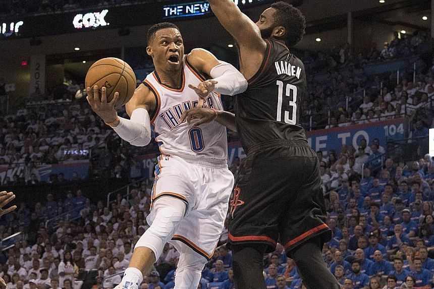 Russell Westbrook of the Oklahoma City Thunder drives around James Harden of the Houston Rockets while shepherding his team to a 115-113 win in Game Three of the Western Conference play-offs. His on-court decision making was crucial in the win.