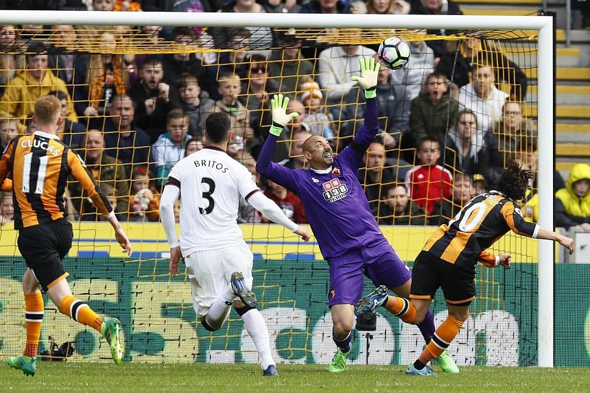 Winger Lazar Markovic, on loan from Liverpool, scoring Hull's first goal past Watford goalkeeper Huerelho Gomes and defender Miguel Britos. The 2-0 win kept them two points above the relegation zone as Swansea, one spot back, also beat Stoke 2-0.