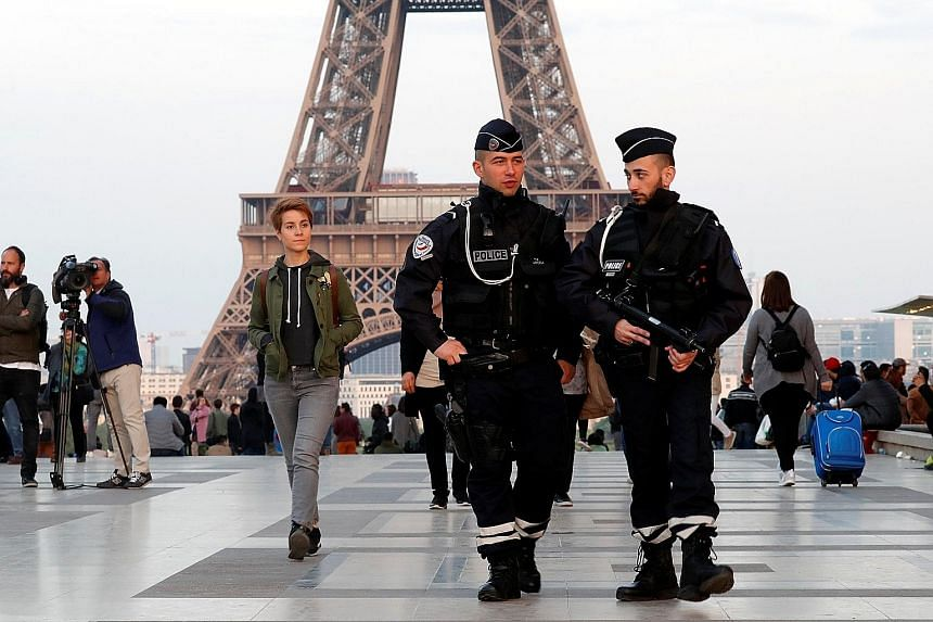 Police patrolling an area near the Eiffel Tower last Friday, the day after a policeman was killed and two others were wounded in a shooting incident on Paris' Champs Elysees.