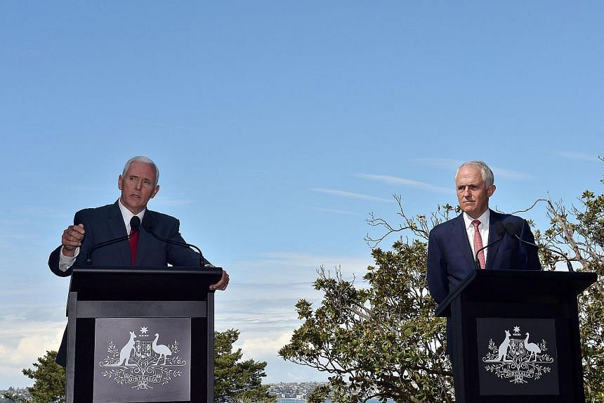 """US Vice-President Mike Pence (left) told media at a joint news conference held with Australian Prime Minister Malcolm Turnbull in Sydney yesterday that the deal would be subject to vetting and honouring it """"doesn't mean that we admire the agreement""""."""