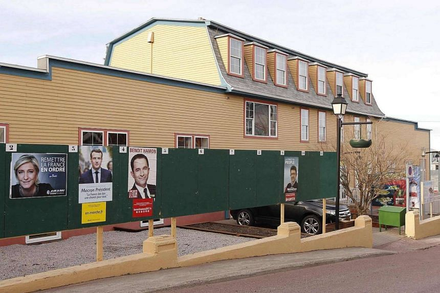 Campaign posters of candidates are seen in Saint Pierre, on the French overseas archipelago of Saint-Pierre et Miquelon, during the first round of the French presidential election on April 22, 2017.