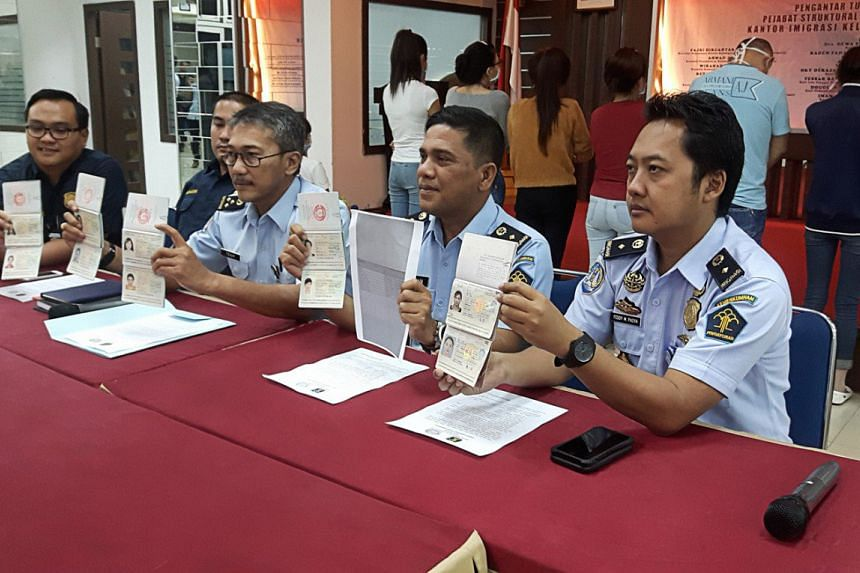 Batam Immigration officials show copies of the passports of 10 Chinese and Vietnamese citizens arrested for allegedly working as sex workers in Batam, Riau Islands, in a press conference.