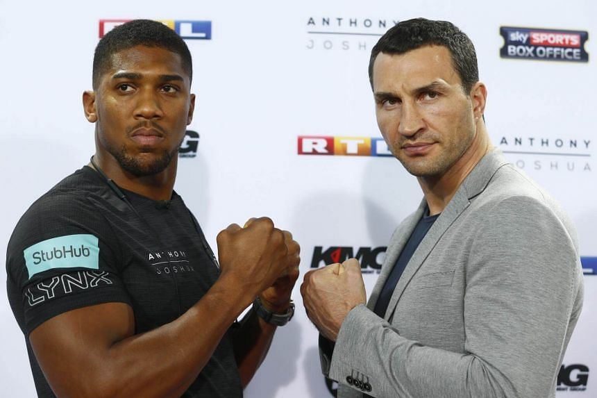 Anthony Joshua (left) and Wladimir Klitschko at a press conference in RTL, Cologne, Germany on Feb 16, 2017.