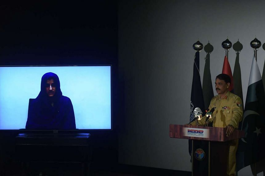Pakistan's army spokesman Major General Asif Ghafoor gives details of captured would-be female suicide bomber Naureen Leghari (on screen) during a press conference in Rawalpindi on April 17, 2017.