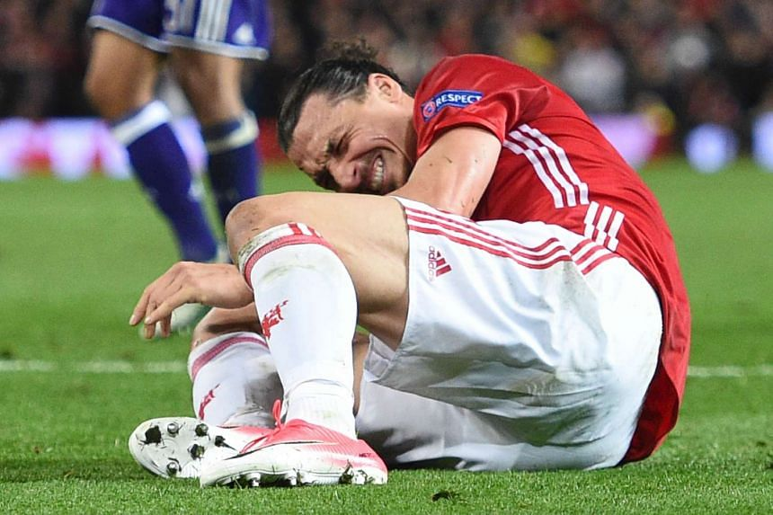 Manchester United striker Zlatan Ibrahimovic reacts after injuring his knee in the match against Anderlecht on April 20, 2017.