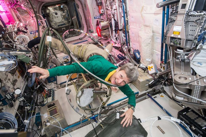 NASA astronaut Peggy Whitson floats through a tangle of cables inside the Columbus module aboard the International Space Station (ISS), in space, on Dec 8, 2016.