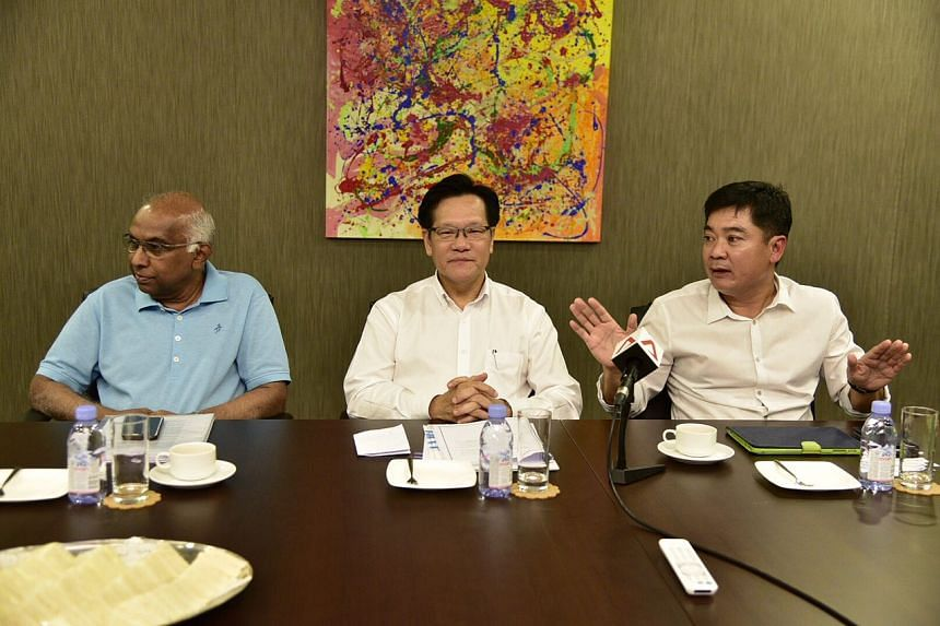 Team LKT members S. Thavaneson, Lim Kia Tong and Bernard Tan attend a media briefing ahead of FAS election, on April 24, 2017.