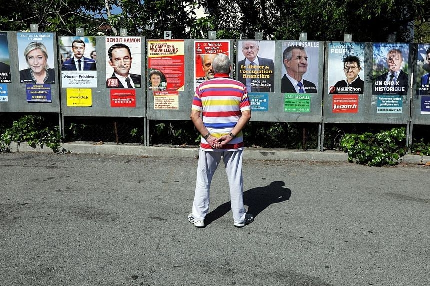 Sizing up the candidates running in the French presidential election, in Saint Andre de La Roche, near Nice.