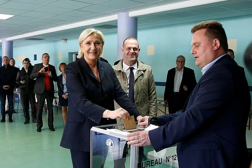 Far-right leader Marine Le Pen, who cast her ballot in Henin-Beaumont, northern France, proposes a more disruptive programme of higher social spending than Mr Macron, who favours gradual economic deregulation. Mr Emmanuel Macron at a polling station