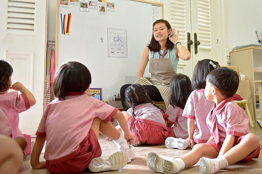 St James' Church Kindergarten teacher Stephanie Soo guiding her Nursery 2 pupils in basic pronunciation during an English lesson. The 21-year-old, who benefited from the dedicated practicum programme for trainee pre-school teachers and joined the kin