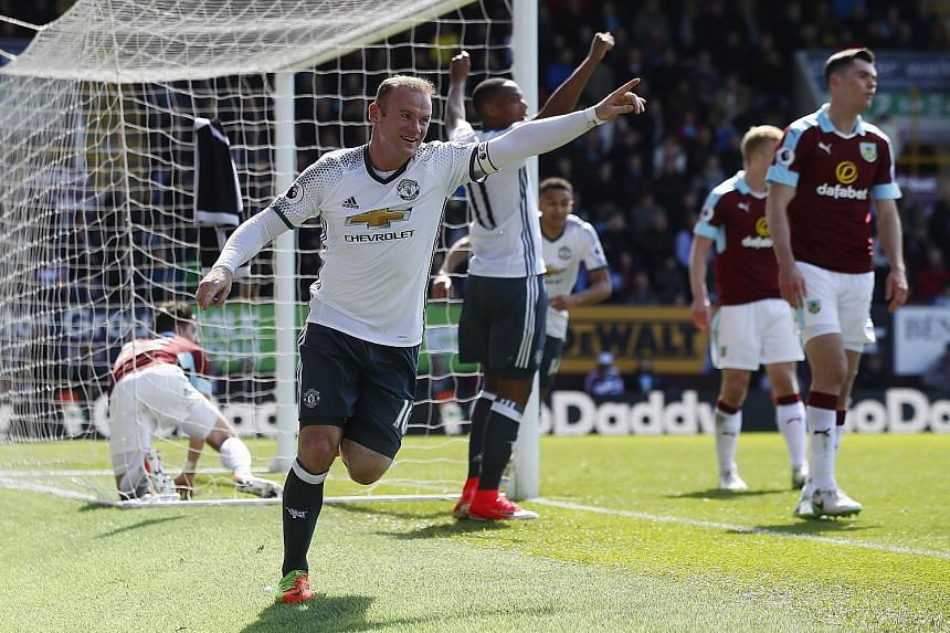 Wayne Rooney celebrating after scoring Manchester United's second goal in the 2-0 win against Burnley yesterday. In only his second league start of the year, he scored for his club for the first time since January.