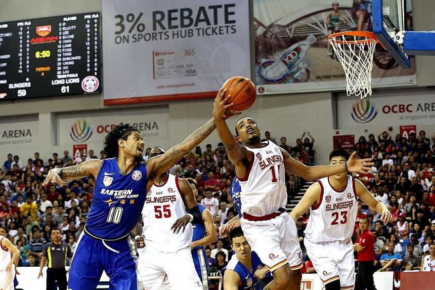 Slingers' guard Xavier Alexander (No. 15) battling for a loose ball with guard Tyler Lamb (No. 10) of the Long Lions. The Slingers have lost back-to-back ABL Finals.