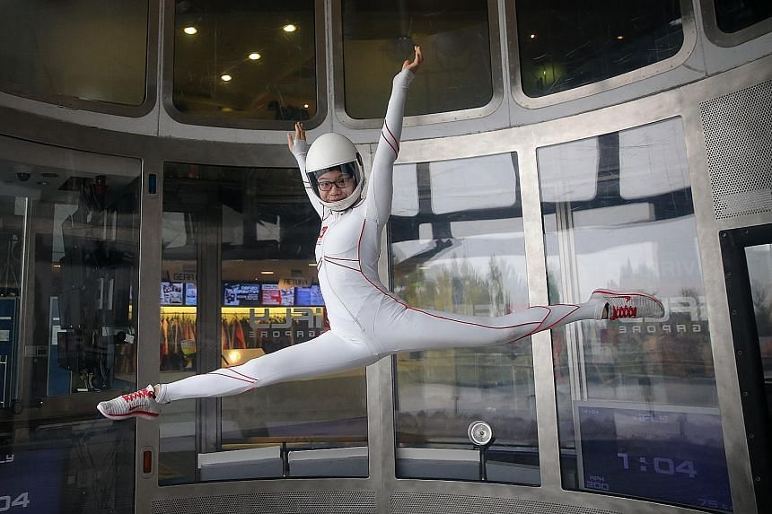 Kyra Poh, 14, perfecting her indoor skydiving technique in the wind tunnel at iFly Singapore. She was introduced to the sport when she was only eight years old and began competing a year later.