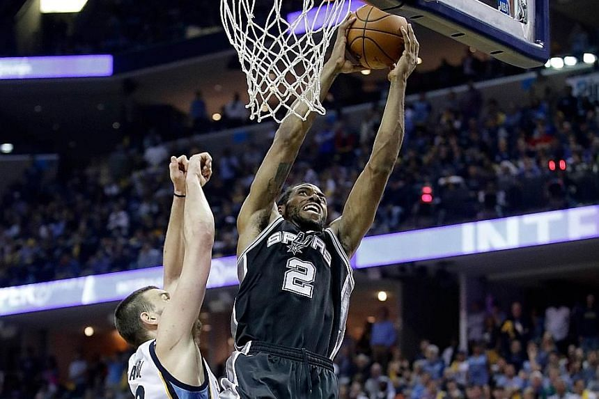 Kawhi Leonard of the San Antonio Spurs shooting against the Memphis Grizzlies in Game Four of the Western Conference quarter-finals. He had a career-high 43 points but the Grizzlies forced the overtime win.