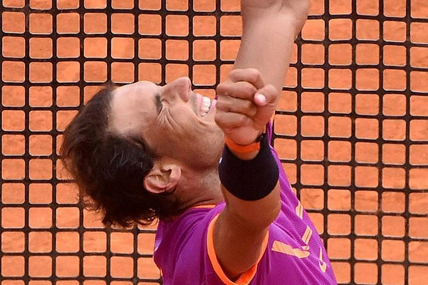 Arms raised in victory, Rafael Nadal celebrates his 10th Monte Carlo Masters title. The Spaniard said that the win here is important preparation in his bid for a 10th French Open next month.
