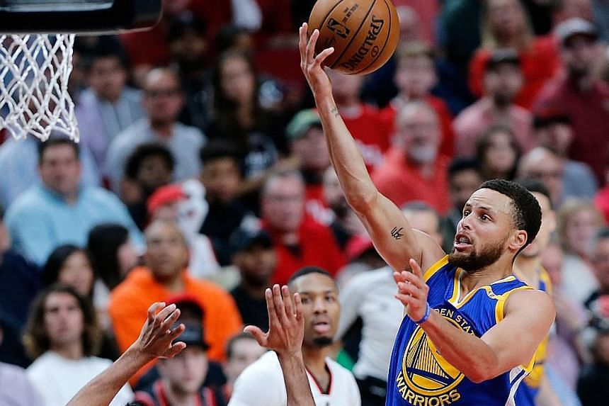 Golden State Warriors point guard Stephen Curry scoring on a lay-up over Portland's C.J. McCollum. Curry poured in 34 points, with 14 coming in the fourth quarter as the Warriors beat the Trail Blazers 119-113 to take a commanding 3-0 lead in their f