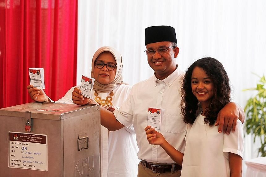 Jakarta gubernatorial candidate Anies Baswedan casting his vote with wife Fery Farhati Ganis and daughter Mutiara Annisa in the election in South Jakarta, Indonesia, last Wednesday.