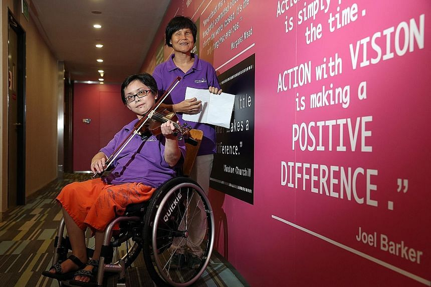 Violinist Huang Li Zhen, 29, who has lupus, and blind vocalist Wan Wai Yee, 44, are part of the 30-member Purple Symphony Ensemble. Singapore's largest disability- inclusive orchestra receives many performance requests, but it was challenging to arra