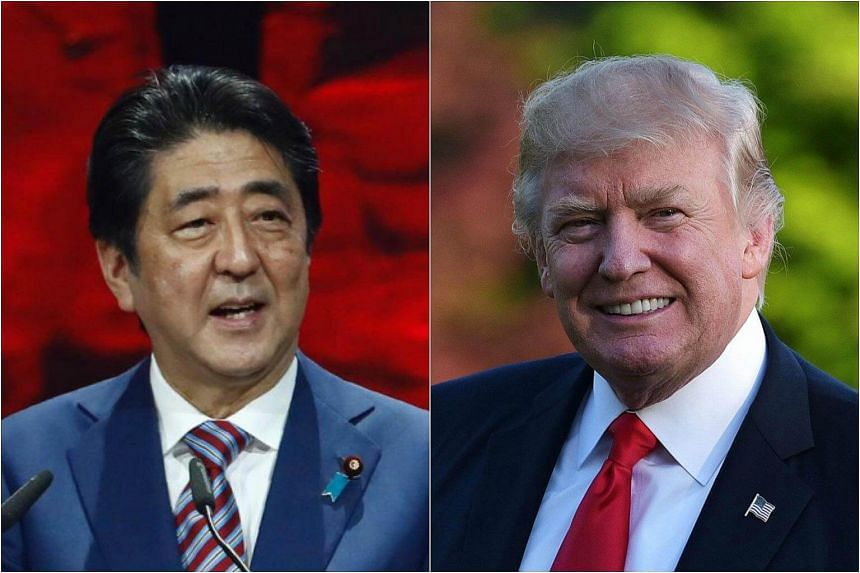 Japanese Prime Minister Shinzo Abe (left) told reporters after a telephone call with US President Donald Trump that he appreciated the US leader's stance of showing that all options are on the table when it comes to dealing with North Korea.