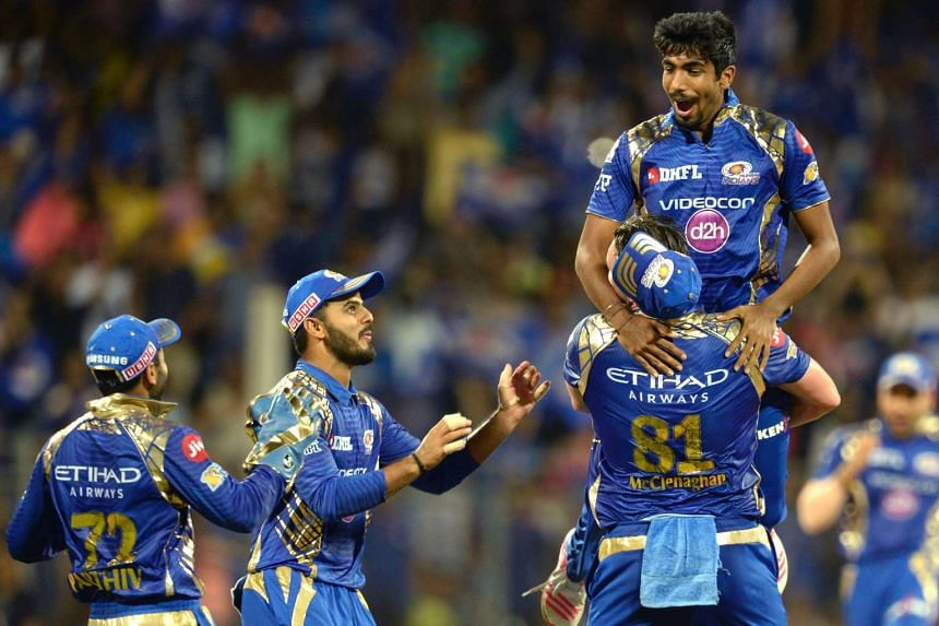Mumbai Indians cricketer Jasprit Bumrah (right) celebrating with his teammates after taking the wicket of Delhi Daredevils batsman Rishabh Pant during the 2017 Indian Premier League (IPL) Twenty20 cricket match between Mumbai Indians and Delhi Darede