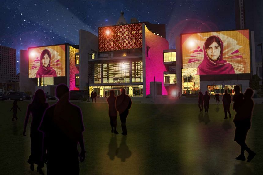 A rendering of an art display, which features Nobel Peace prize laureate Malala Yousafzai, projected on the National Underground Railroad Freedom Center during Cincinnati's Blink festival.