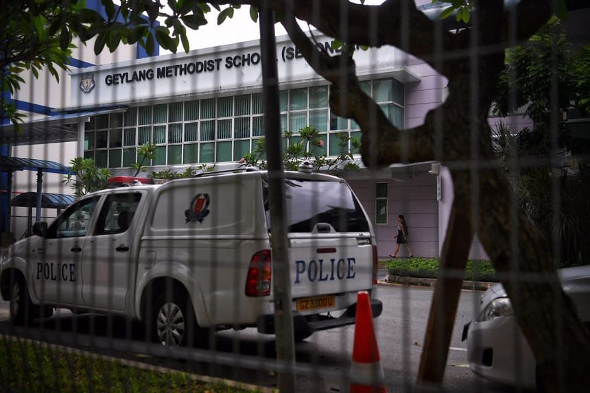 A police car was seen inside Geylang Methodist School (Secondary). A student died after he was struck by a goal post in a freak accident on April 24, 2017.
