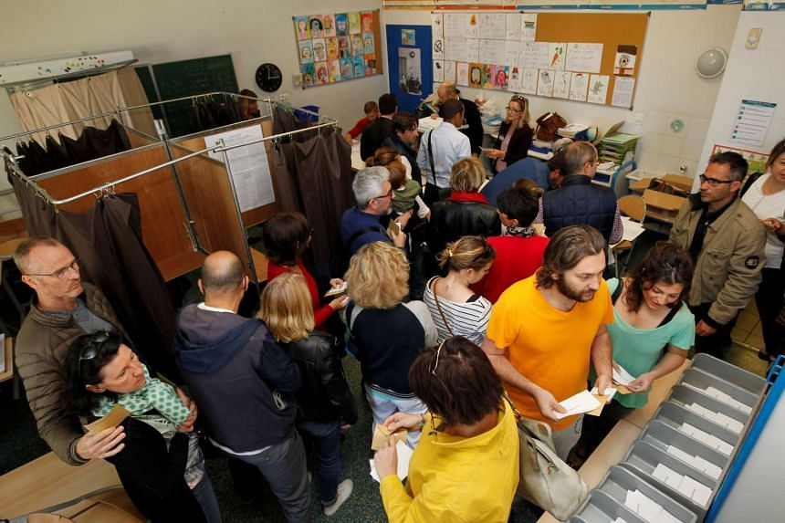 People waiting to vote in the first round of the French presidential election at a polling station in Marseille, France, on April 23, 2017.