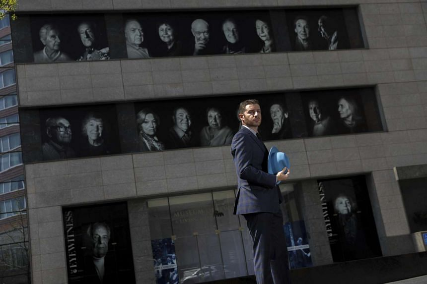 Artist B.A. Van Sise in front of his installation on the facade of the Museum of Jewish Heritage in New York, on April 20, 2017.