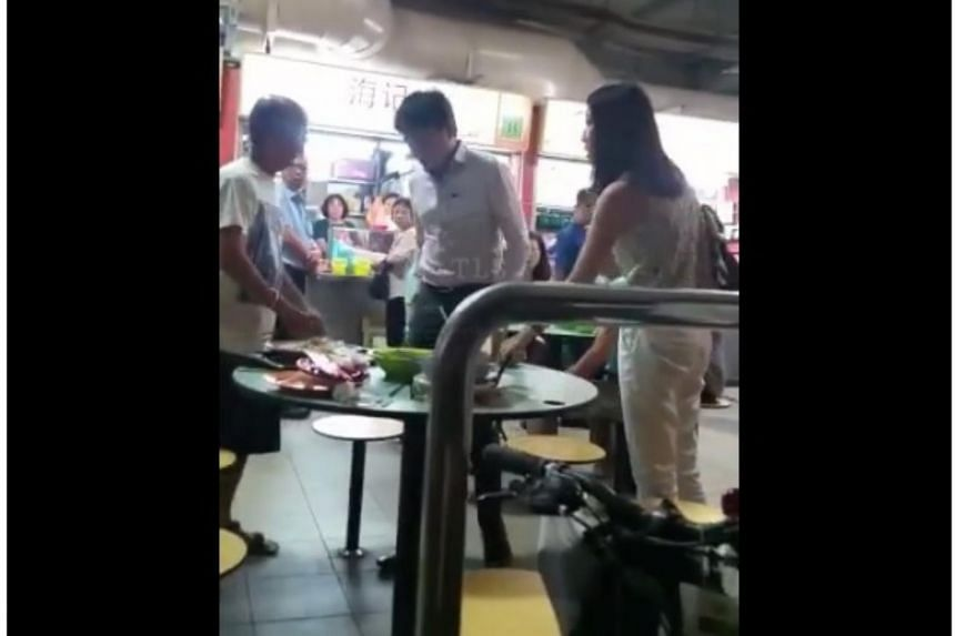 The video showed the woman, who was dressed in white, shouting at the elderly man, before her male companion shoves the elderly man from behind.