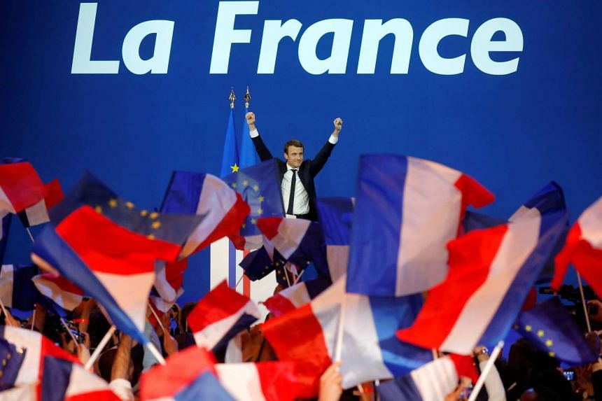 Emmanuel Macron celebrating at the Parc des Expositions hall in Paris after partial results in the first round of the 2017 French presidential election on April 23, 2017.