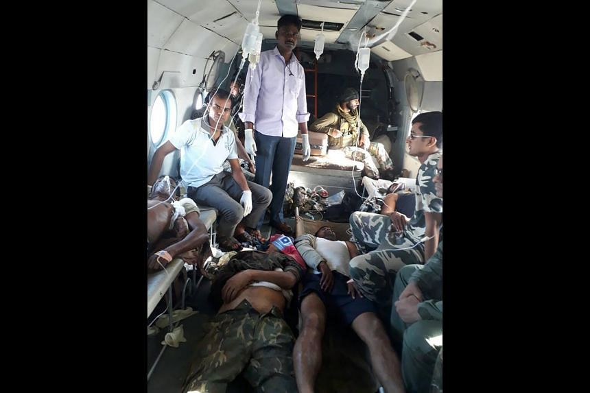 Wounded Indian security personnel being treated in an army helicopter as they are airlifted to a hospital following an attack by Maoist rebels in Sukma district of Chhattisgargh state on April 24, 2017.