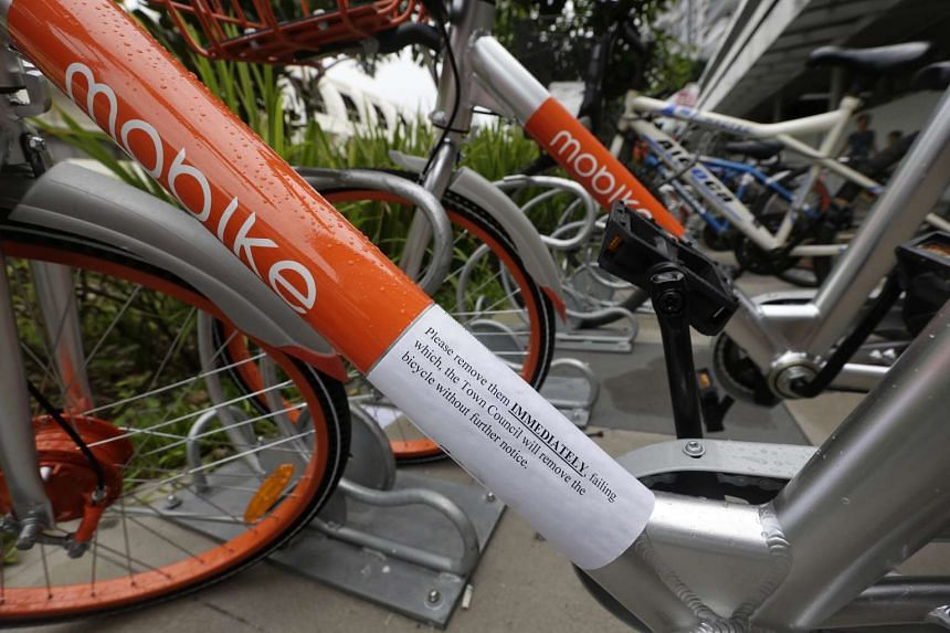 A removal notice issued by the Town Council on a Mobike bicycle. The bike-sharing platform will be adding 50 bicycle parking zones in Singapore.