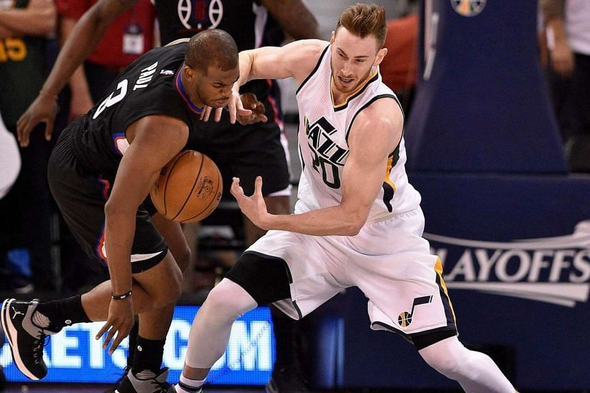 Chris Paul of the Los Angeles Clippers and Gordon Hayward of the Utah Jazz try for the loose ball in the second half of the 111-106 Clipper victory, in Game Three of the Western Conference Quarterfinals during the 2017 NBA Playoffs on April 21, 2017,