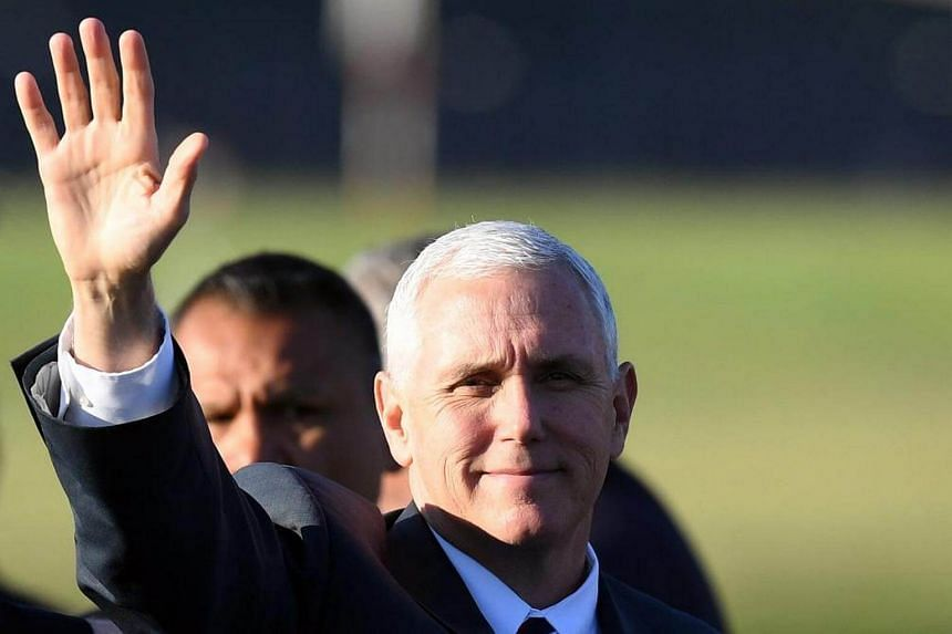US Vice President Mike Pence waving before boarding an aircraft departing Sydney International Airport in Australia on April 24, 2017.