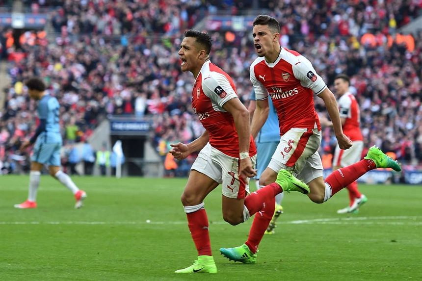 Arsenal'striker Alexis Sanchez (left) celebrates scoring the winning goal with Arsenal defender Gabriel.