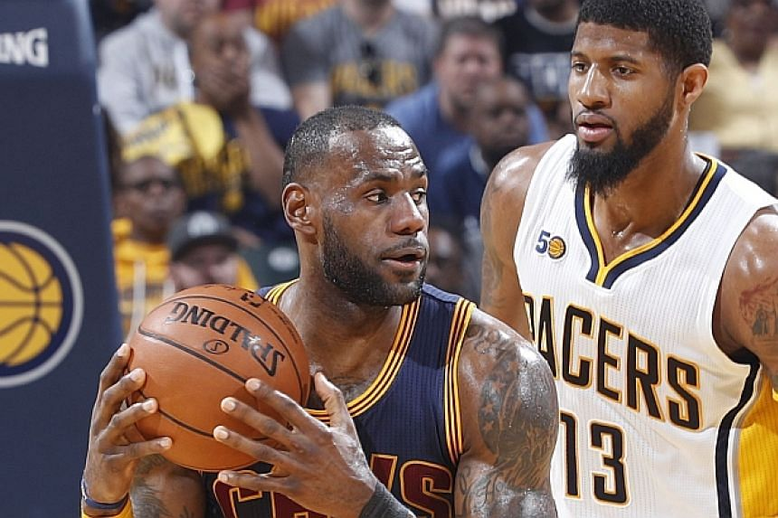LeBron James handles the ball against Indiana's Paul George the Eastern Conference quarterfinals on April 23, 2017.