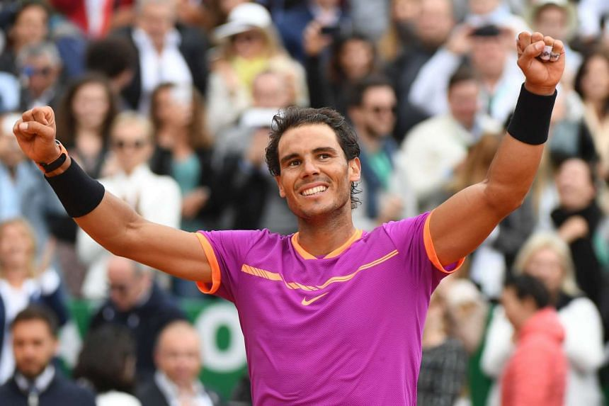 Spain's Rafael Nadal celebrates after winning at Monte-Carlo again on April 23, 2017 in Monaco.