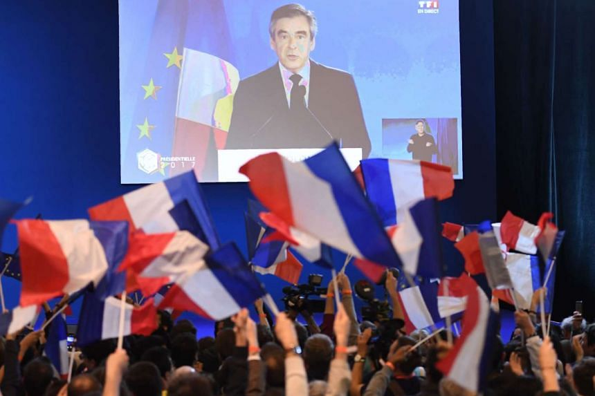 Francois Fillon is seen on a video screen endorsing Emmanuel Macron in Paris on April 23, 2017.