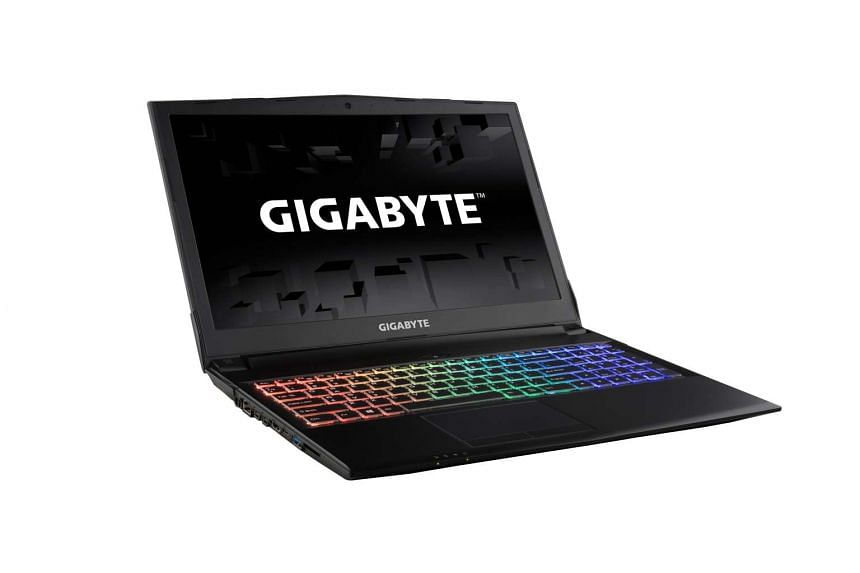Gigabyte Sabre 15 looks plain for a gaming laptop, but it does come alive when turned on, thanks to its colourful RGB-backlit keyboard.