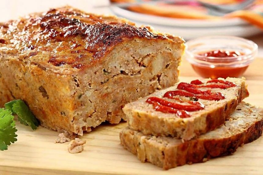 Before slicing, you'll want to let the baked meatloaf rest in its fat and juices for 10 minutes. Then you'll have the juiciest meatloaf ever.