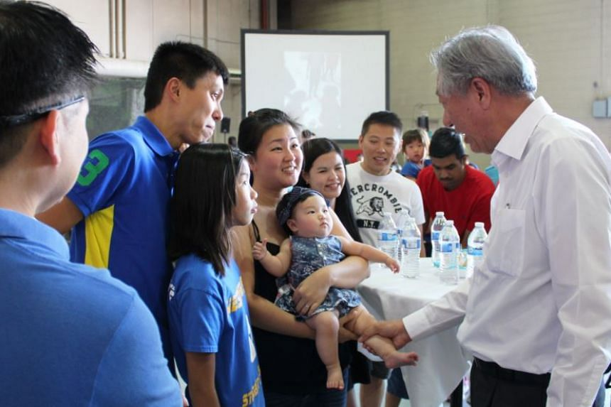 DPM Teo interacting with RSAF personnel and their families.