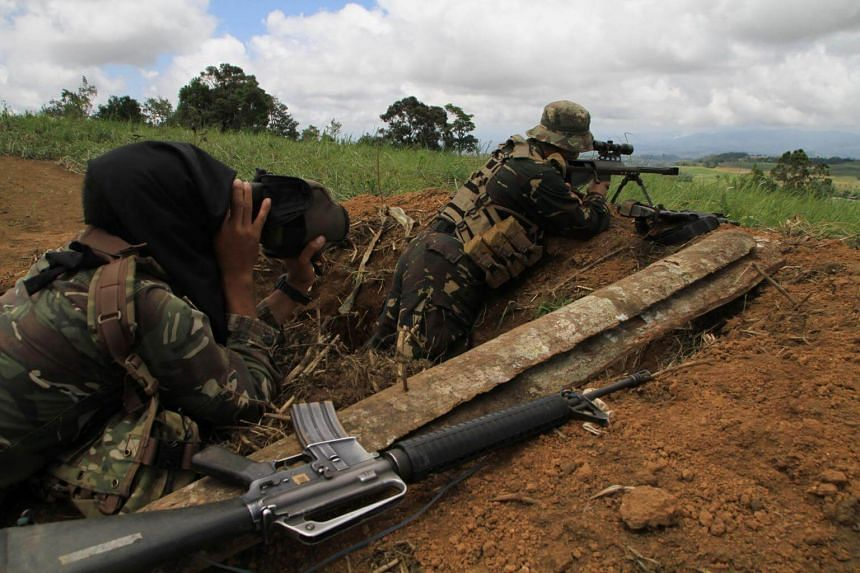 Philippine military snipers scan the horizon as they engage Islamic State-affiliated extremists in the mountain area of Piagapo town, Lanao del Sur province, on the southern island of Mindanao on April 25, 2017.