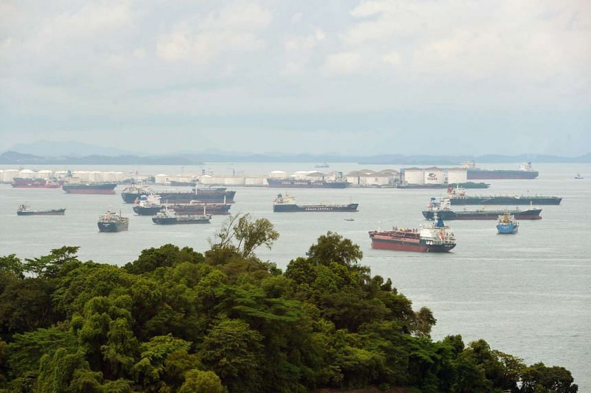 Oil tankers congregate in front of Pulau Sebarok, an oil storage and refueling port on one of the southern islands of Singapore.