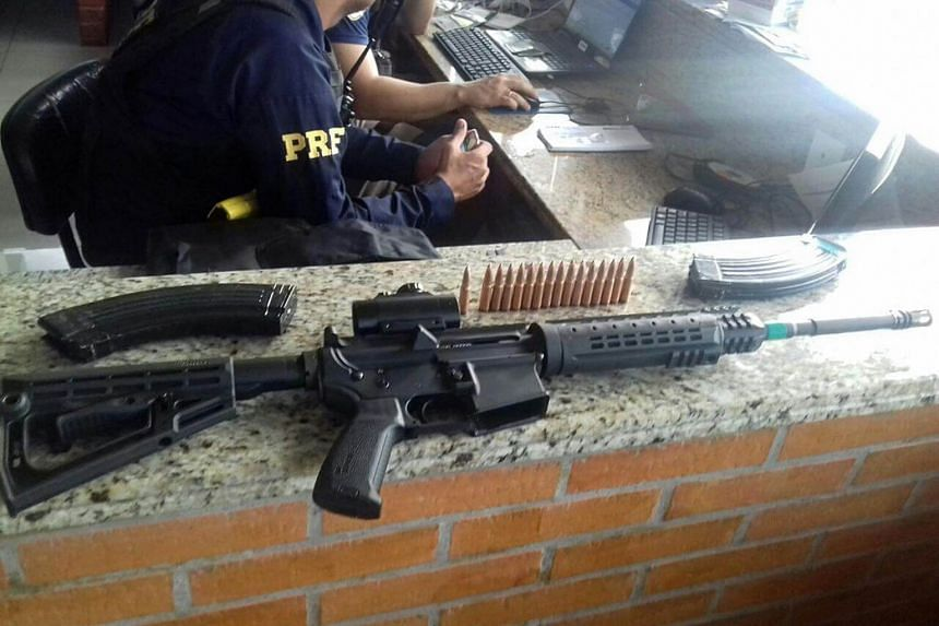 A handout photo made available by the Brazilian Federal Highway Police, shows a rifle seized in the city of Sao Miguel do Iguacu, Brazil, on April 24, 2017.